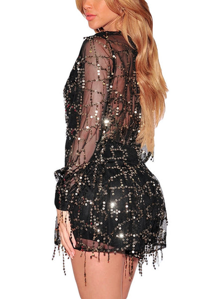 Left side view of model in black flowing sequins long sleeves romper