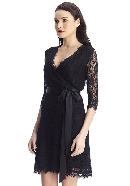 Left side view of model in black lace overlay plunge wrap-style dress