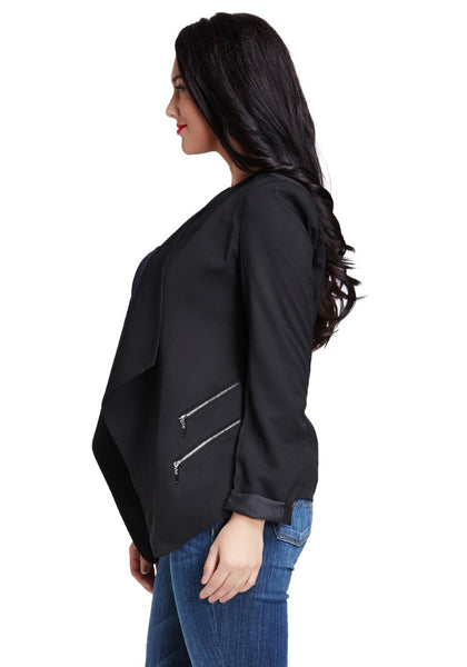 Left side view of model in black padded-shoulder draped blazer