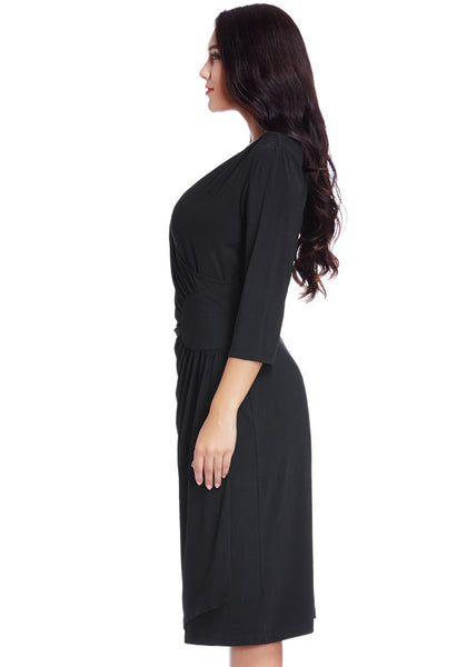 Left side view of model in black side-patch wrap midi dress