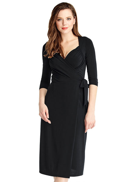 Left side view of model in black sweetheart neckline wrap dress