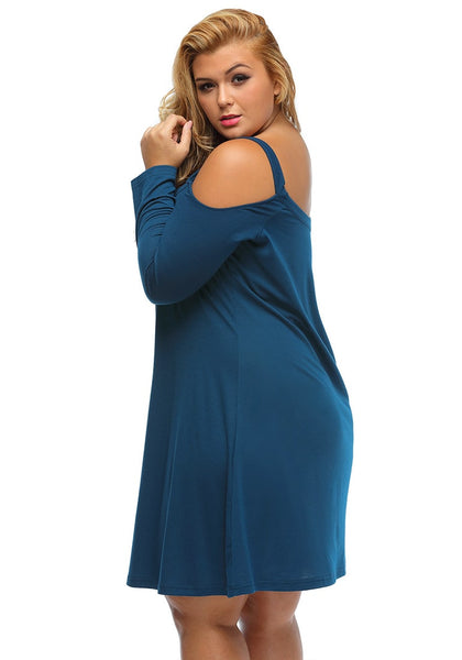 Left side view of model in blue cold-shoulder tunic dress