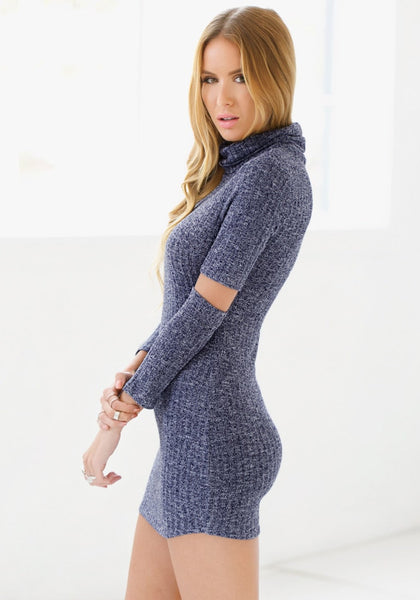 Left side view of model in blue melange turtleneck tunic