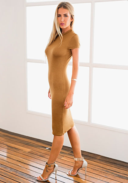 Left side view of model in brown midi sheath dress
