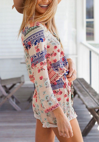 Left side view of model in floral lace up romper