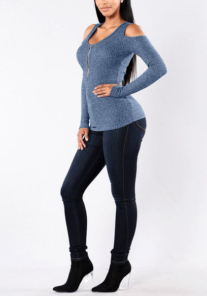 Left side view of model in grayish blue cold shoulder zip-front top