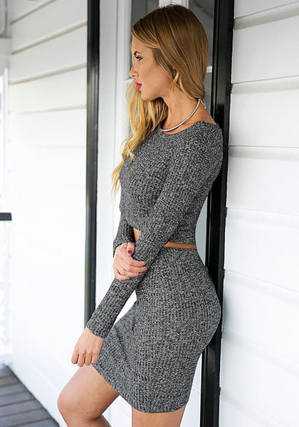 Left side view of model in grey knitted skirt co-ord set