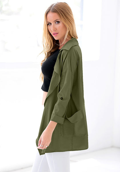 Left side view of model in moss green draped cardigan