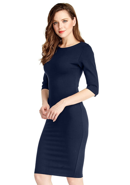 Left side view of model in navy classic bodycon midi dress