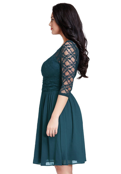 Left side view of model in peacock lace crop-sleeves skater dress