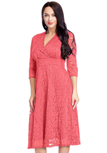 Left side view of model in plus size coral surplice midi dress