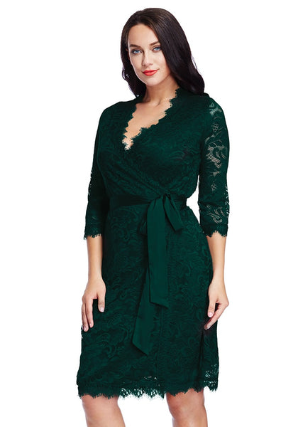 Left side view of model in plus size deep green lace crop sleeves wrap dress