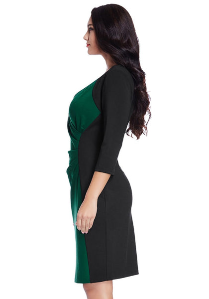 Left side view of model in plus size green raglan sleeve dress