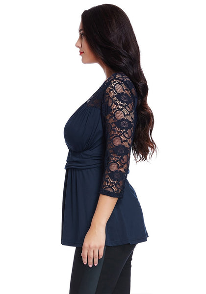 Left side view of model in plus size navy lace navy wrap top
