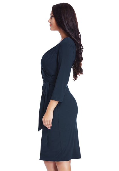 Left side view of model in plus size navy sweetheart wrap midi dress