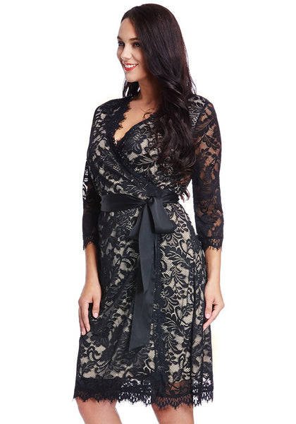 Left side view of model in plus size neutral lace crop sleeves wrap dress