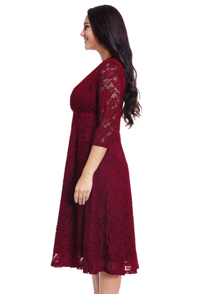 Left side view of model in plus size red lace surplice midi dress
