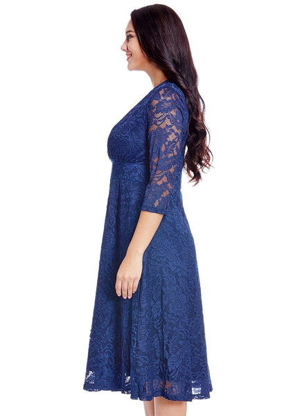 Left side view of model in plus size royal blue lace surplice midi dress