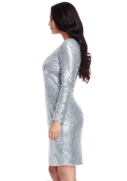 Left side view of model in plus size silver sequined party dress