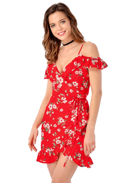 Left side view of model in red floral ruffled cold-shoulder wrap dress