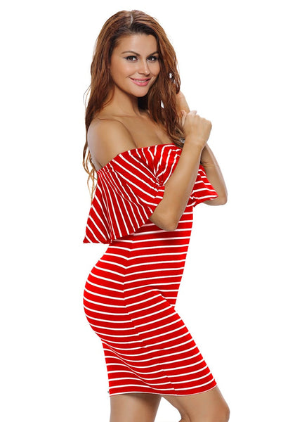 Left side view of model in red striped ruffled off-shoulder dress
