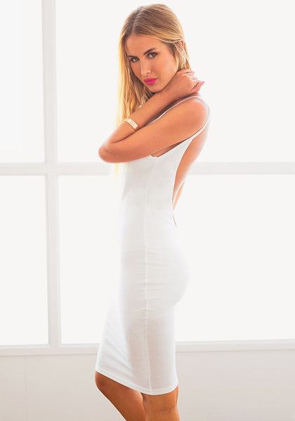 Left side view of model in white ribbed cami bodycon dress