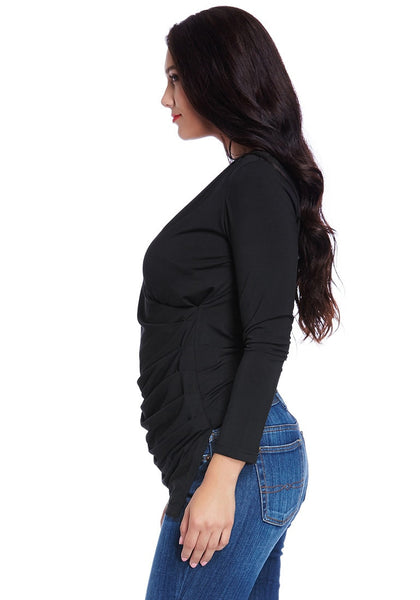 Left side view of model wearing black ruched asymmetrical wrap top