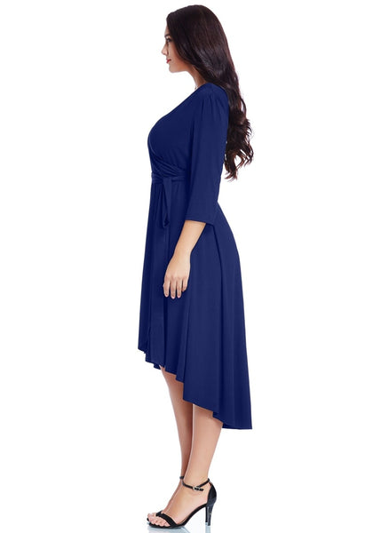 Left side view of model wearing plus size royal blue high-low wrap skater dress