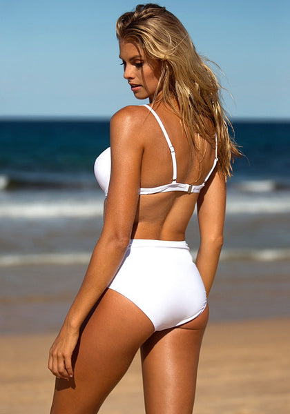Left side view of model wearing white crisscross-front monokini in the beach