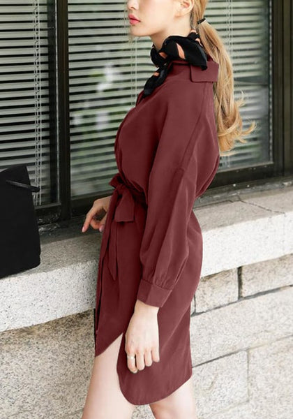 Left side view of woman in burgundy tie belt shirt dress