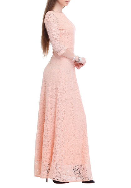 Left side view of woman wearing a pink maxi lace dress