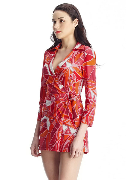 Left view of model in abstract wrap-style long sleeves romper