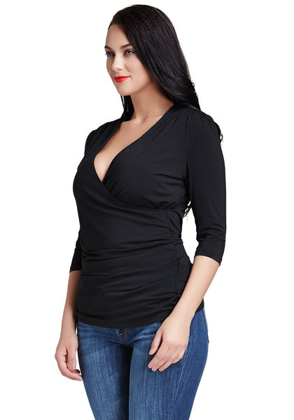 Left view of model in black ruched surplice top