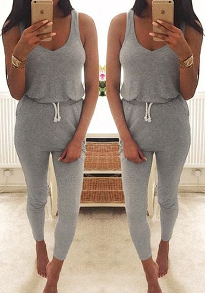 Mirror image of model in grey drawstring jumpsuit