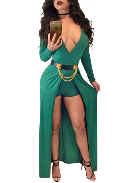 Mirror shot of woman in green wrap plunge-neck belted romper dress