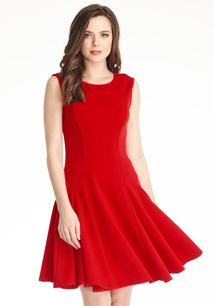 Model flips skirt of red sleeveless skater dress