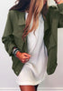 Model in a moss green button-down military jacket and white dress