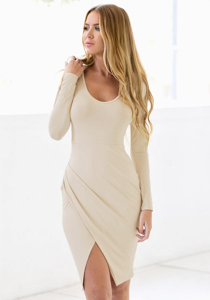 Model in apricot draped wrap dress