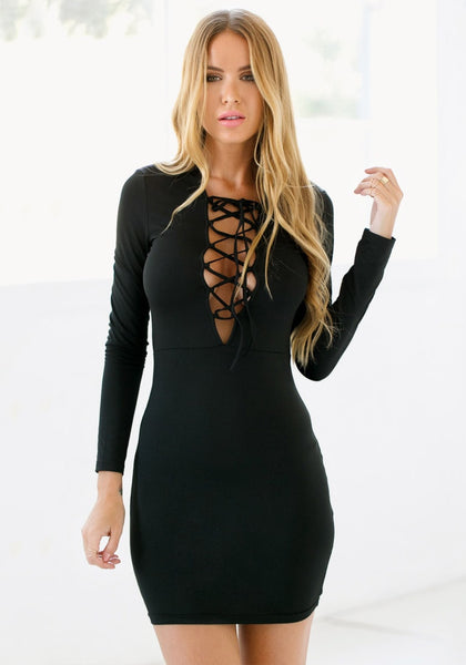 Model in black lace-up mini dress