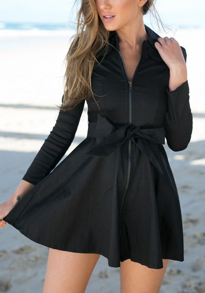 Model in black zip-up skater dress