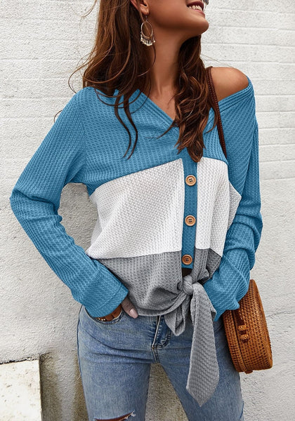 Model in blue V-neckline button-up tie-front colorblock waffle knit top