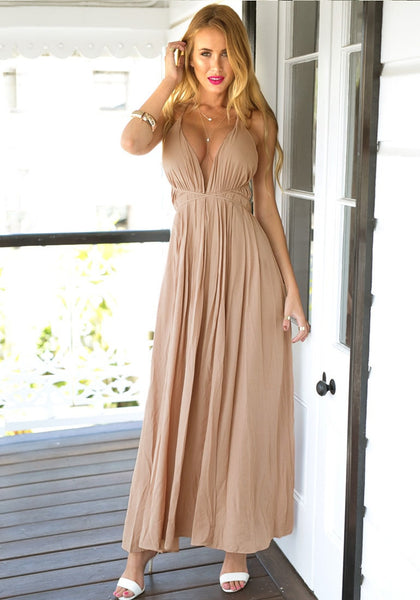 Model in cameo color strappy plunge dress