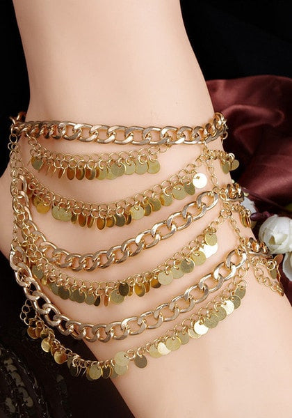 Model in gold paillette boho anklet