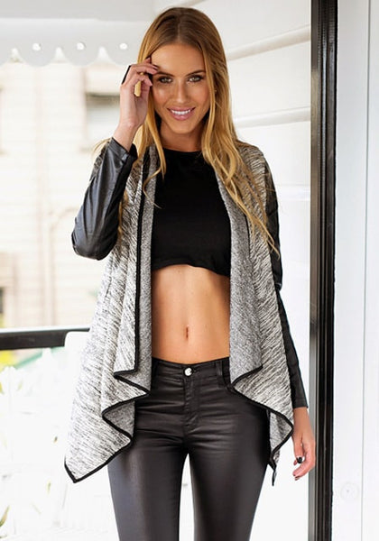 Model in light grey draped cardigan and crop top