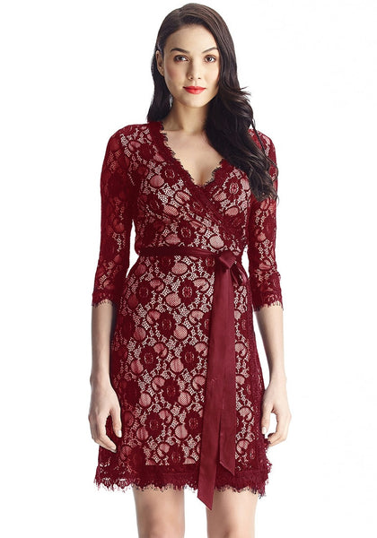 Model in maroon lace overlay plunge wrap-style dress