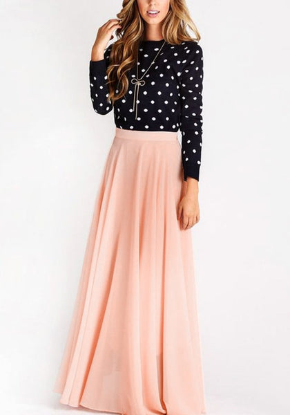 Model in pink chiffon maxi skirt