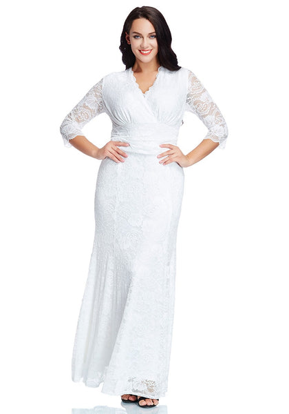 Model in plus size white lace long dress poses with two hands on the waist