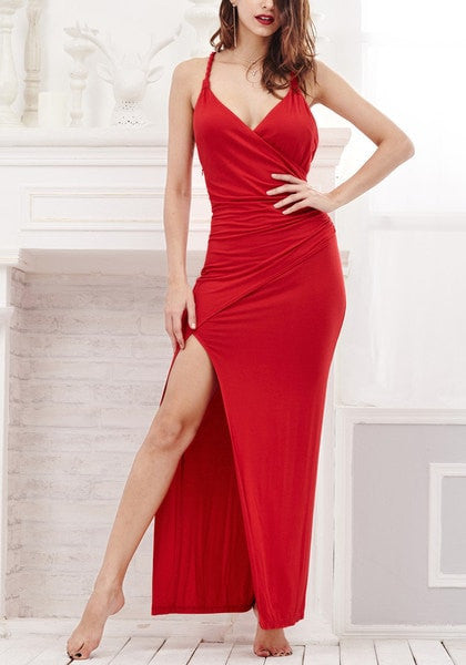 Model in red side slit dress with hands on hips
