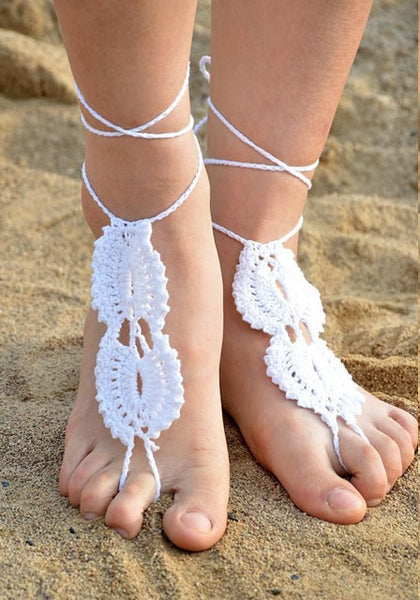 Model in white crochet barefoot sandals