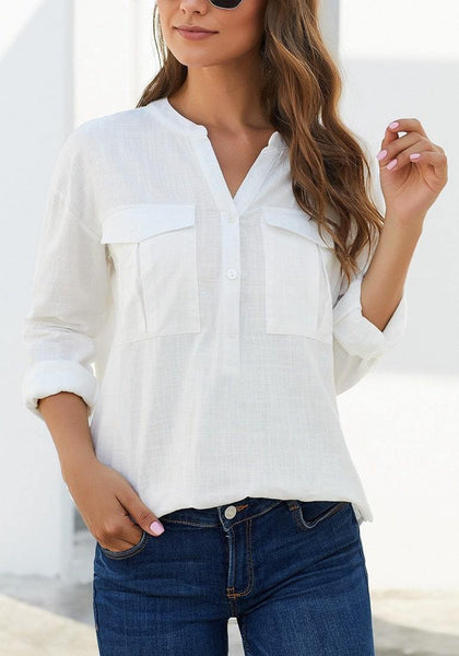 Model in white notched henley cuffed sleeves blouse